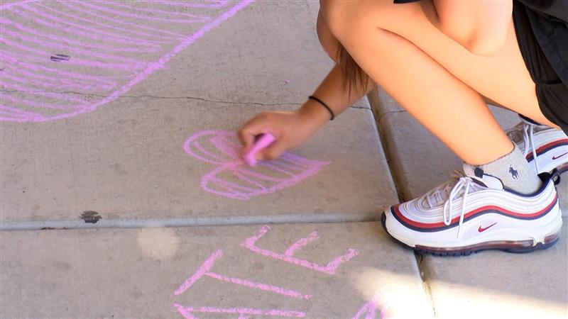 Students in LAC decorate the sidewalk with positive messages for teachers. LAC is one of the few student organizations that has been active during virtual learning.