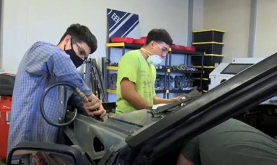 Andrews Class Getting Hands-On Experience Restoring Vehicle