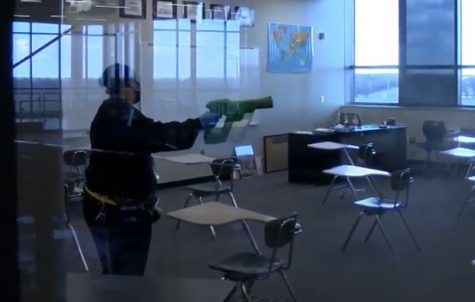 Custodian Rose Hill uses an electrostatic sprayer to disinfect a classroom. This is one of the new steps custodians must take each day in order to keep the building safe and clean.